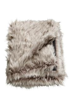 Blanket with a long-hair faux fur front and cotton canvas back.