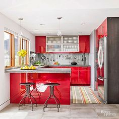 Glossy red cabinets capture a sleek modern look in a real-world budget in this red hot kitchen! Look here for more small kitchen makeover ideas: Kitchen Remodel Small, Kitchen Design, Kitchen Tiles, Kitchen Decor, Modern Kitchen, Colorful Kitchen Decor, Tile Countertops Kitchen, Small Kitchen Makeovers, Kitchen Layout
