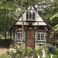 Dutch barn style shed.....looks like a Hansel & Gretel cottage