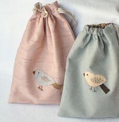 drawstring bags with applique birds