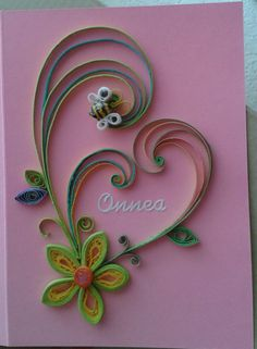 Heart shape of flower and a little beast by quilling