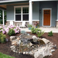 Landscaping tip: the hard and soft combo of flowers and rocks gives this yard depth