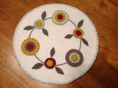 Primitive Floral Candle Mat Penny Rug by olivialight