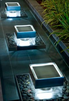 Multiple water fountain sculptures for a contemporary home