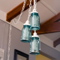 DIY Mason Jar Chandelier!  Use this tutorial to add light and life to any room  with a charming and functional Mason Jar Chandelier!