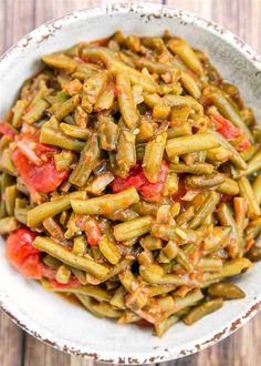 Creole Green Beans Recipe - transform canned green beans into something amazing! Green beans, bacon, onion, green pepper, brown sugar, mustard, stewed tomatoes, and Worcestershire sauce. SO good! I could make a meal out of these green beans! Great with chicken, pork, and beef. Ready in 20 minutes! #greenbeans #vegetable #sidedish #tomatoes Cajun Green Beans Recipe, Green Beans Bacon Onion, Green Beans And Tomatoes, Stewed Tomatoes, Green Bean Recipes, Quick Recipes, Whole Food Recipes, Saute Onions, Vegetable Side Dishes
