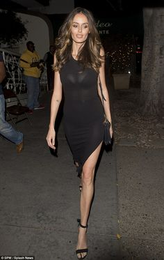 Sheer perfection: Nicole Trunfio puts on a  daring display in a clinging black dress that showed off her underwear as she ambled out of Madeo restaurant in Hollywood on Tuesday