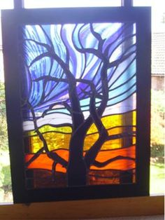 Stained Glass Winter Tree: The Winter Tree design for this glass art work was based on photos and drawings from a range of sources, including my own photos of bare trees against