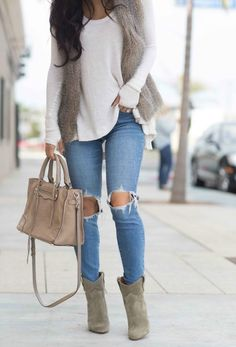 Perfect grey Winter day--skinny distressed light rinse jeans, a lightweight cream colored sweater, taupe faux fur vest, taupe tote, & taupe colored ankle boots. Long diffused, scrunched curls because they take 10 min and look good all day! Weekend perfection.