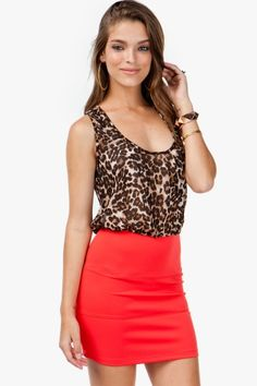 A wild and fiery 2fer dress with a sheer, leopard printed chiffon top and a scuba banded skirt. Racerback. Chest pocket.