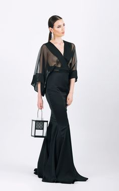 Long evening gown with large sleeves      Mermaid skirt shape  ...