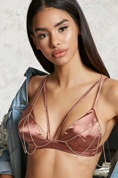 A high-polish body chain featuring a cutout design that drapes over the bust area and a lobster clasp closure.