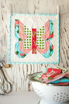 Social Butterfly mini quilt pattern by Lella Boutique. Gooseberry fabric by Vanessa Goertzen of Lella Boutique for Moda. Ships to stores October 2015.