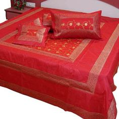 The 5 Piece Silk Double Bed Cover set contains: A. One Double Bed Cover in traditional hand floral embroidery of Jaipur.The sheet can be used both as a Bed Sheet as well as the bedcover. B. Two matching pillow covers C. Two matching cushion covers Specifications: Colour : Red Fabric : 100 % Export Quality pre-shrunk Poly Dupion Silk of thread count 220x80.