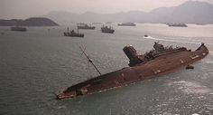 "Shipwreck of the Queen Elizabeth Hong Kong harbour from the film ""The Man with the Golden Gun"" Rms Queen Elizabeth, Abandoned Ships, Abandoned Places, Abandoned Buildings, Hong Kong, Merchant Navy, Ghost Ship, Shipwreck, Tall Ships"