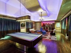 Luxury penthouse for sale in Las Vegas, complete w/ lounge featuring bar, pool table, ultra-modern decor & lighting