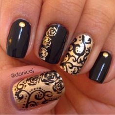 Black and gold nail designs.