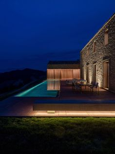 The stunning AP House designed by GGA Architects and built on a hill in Urbino provides a contemporary take on the traditional Italian stone house. Facade Lighting, Exterior Lighting, Lighting Design, House Lighting, Concrete Architecture, Modern Architecture Design, Central Building, Outdoor Light Fixtures, Outdoor Lighting