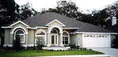 Find your dream sunbelt style house plan such as Plan which is a 3130 sq ft, 5 bed, 4 bath home with 2 garage stalls from Monster House Plans. 4 Bedroom House Plans, Cottage House Plans, Cottage Homes, Florida Homes Exterior, Stucco House Colors, Florida House Plans, Stucco Homes, Monster House Plans, Bungalow House Design