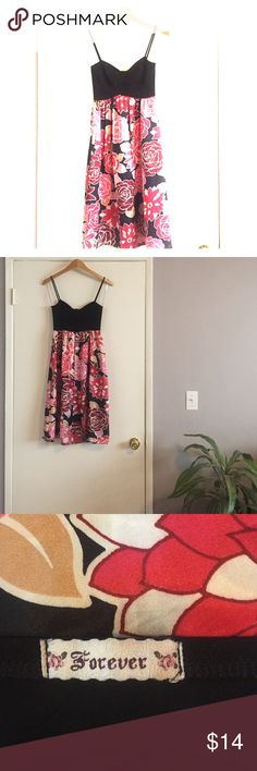 Floral midi dress Beautiful floral dress with a fitted black bodice. Dress it up with heels for a special event or wedding! Worn a handful of times. I'm 5'4 and it hits right below my knees. 100% Polyester. Forever 21 Dresses