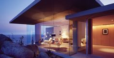 On a hill, surrounded by glass walls: Casa Finisterra by Steven Harris Architects