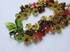 FALL BLOOMS- Lucite Flowers of Fall Colors, Glass Leaves, Brass, Pearls, Beautiful Bracelet. , via Etsy.