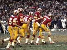 Washington Redskins Hall of Fame defensive end <a gi-track='captionPersonalityLinkClicked' href=/galleries/search?phrase=Deacon+Jones&family=editorial&specificpeople=556843 ng-click='$event.stopPropagation()'>Deacon Jones</a> (75) receives congratulations from his teammates, including quarterback <a gi-track='captionPersonalityLinkClicked' href=/galleries/search?phrase=Joe+Theismann&family=editorial&specificpeople=215194 ng-click='$event.stopPropagation()'>Joe Theismann</a> (7), after…