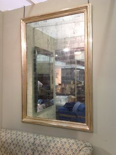 Pair of Verre Eglomise mirrors in one of our antiqued finishes. In water gilded and antiqued frames. London trade client.