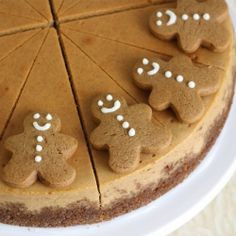 Gingerbread Cheesecake with a homemade gingerbread crust and miniature gingerbread men decoration.