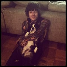 Oliver Sykes with a puppy