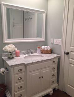 White Vanity marble top, Benjamin Moore Quiet Moments, Small bathroom, classic white bathroom, stained concrete floors, basement bathroom