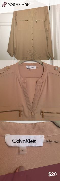 Tan/Gold Calvin Klein Top Tan/Gold Calvin Klein Top. Can be worn long sleeve or 3/4 length. Gold accent buttons and zippers. Excellent condition no stains or rips. 100% polyester. Calvin Klein Tops