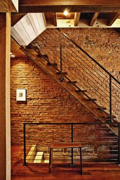 Staircase Design - exposed brick behind stairs