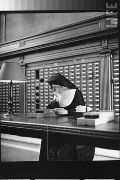 Nun using card catalogue in the New York Public Library - Alfred Eisenstaedt [1944]
