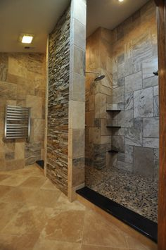 Cool Sculptural Rough Stone Bathroom Design : Cool Sculptural Rough Stone Bathroom Design With Stone Fireplace And Stainless Towel Holder
