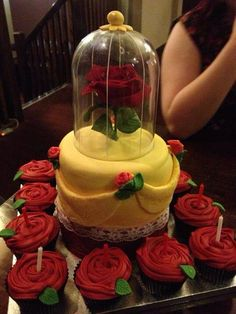 Beauty and the beast cake with rose cupcakes