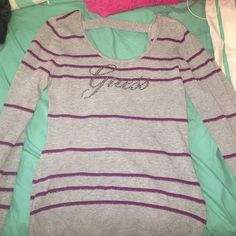 Guess long sleeve tee L Super cute and trendy guess long sleeve bling tee L. Guess tends to run small so please make sure you're normally a large in guess would recommend if you're normally a medium Guess Sweaters