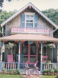 a sweet pink & blue Victorian home, with a Pink bike