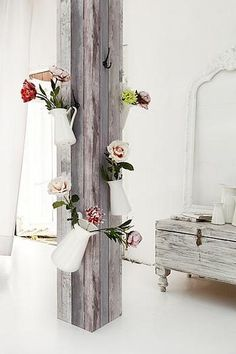 I could do this outside - hang pretty pitchers from hooks on a post and fill with fresh flowers
