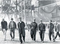 Happy faces on the men of the Clyde., a sunny day a wage in they're pockets and heading for the bar at the end of the day..