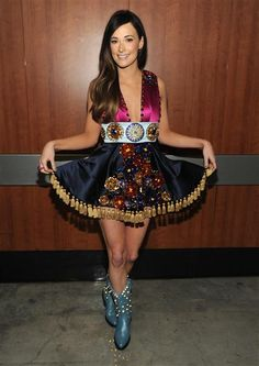 Take one tacky lampshade, add on a belt of bedazzled Girl Scout badges and a truly awesome pair of light-up cowboy boots and voila, you have Kacey Musgraves' onstage getup.