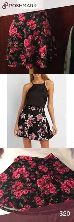 Trendyland Rose party skater skirt Super cute skater skirt with  needlepoint looking roses.  Colors of pink red and green on black make this a very versatile skirt.  NWOT. 95% polyester 5% spandex.  Stretchy waistband.  Pic 2 is showing idea on how to wear and not the actual skirt. Trendyland Skirts Circle & Skater