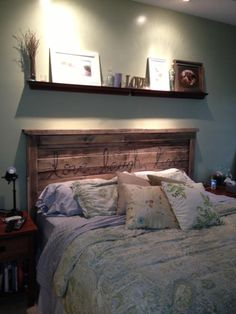 Pallet headboard!? Beautiful but can't really believe that's actually pallet wood. The wood looks like its perfect condition!!!
