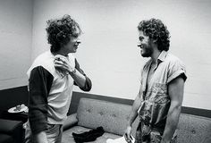 Bob Dylan and Bruce Springsteen chat backstage during the 1975 Rolling Thunder Tour in New Haven, Connecticut.