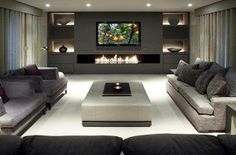 Build in wall: tv, fireplace, shelving. 3 walls of seating...