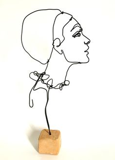 Expressive sculpture in wire: side profile of a woman. A woman with long neck…