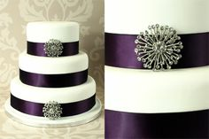 Dark purple ribbon accents each tier of the wedding cake.  A bit of sparkle can be brought to the cake with a brooch.
