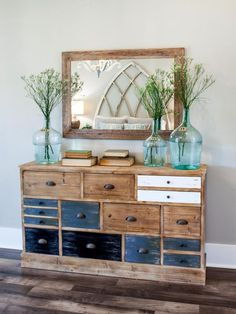 This rustic dresser employs two contrasting wood finishes, and a touch of white, for an eyecatching combination that picks up on the earthy tones in the wood tile flooring.