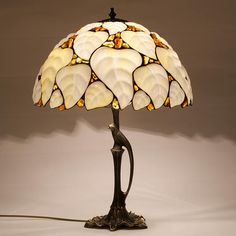 """Tiffany Lamp with Baltic Amber """"Jantar"""" 40 cm in) DETAILS: Stone: Natural Baltic Amber with Glass Base of Lamp is made of brass Height: 53 cm in) Diameter of lampshade: about 40 cm in) bul Stained Glass Lamps, Stained Glass Patterns, Mosaic Glass, Lampe Art Deco, Antique Lamps, Cool Floor Lamps, Bedside Lamp, Amber Glass, Light Fixtures"""