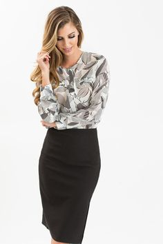 Ditch your boring and stiff work blouse for this gorgeous leaf print button up! This is a lightweight top that's perfect for layering under your favorite blazer. We love how it even looks great with a